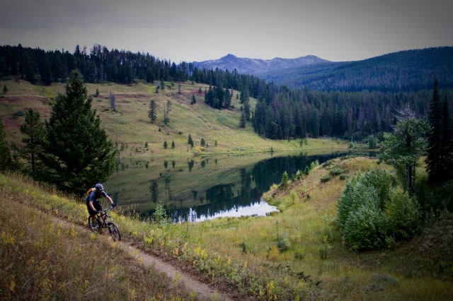Steve Lowry mountain biking by Mystic Lake in the Gallatin National Forest.